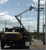 Power company repairing the line.